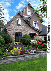 Beautiful house surrounded by a colorful perennial flower...