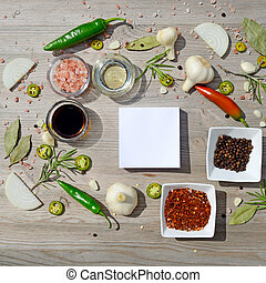 Colorful blank stickers for notes and pepper, bay leaf, rosemary, onions, salt, olive oil, soy sauce on a wooden table