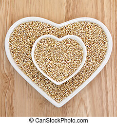 Quinoa Super Food - Quinoa grain health food in heart shaped...