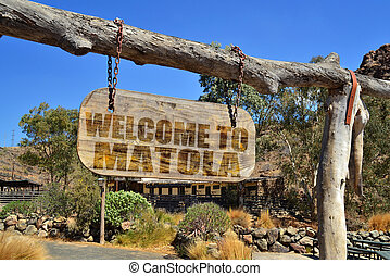 "old vintage wood signboard with text "" welcome to..."