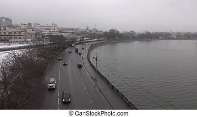 Urban embankment with cars on winter cloudy day. Moscow,...