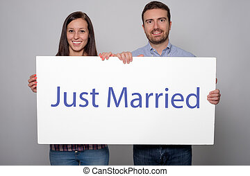 Portrait of of two just married young lovers couple