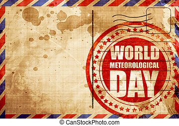 world meteorological day, red grunge stamp on an airmail...