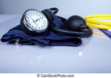 Sphygmomanometer. - Sphygmomanometer on a table. Blood...