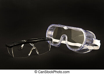 Safety Glasses - Horizontal shot of two pair of safety...