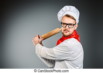 kitchenware - Enraged chef cook brandishing with a rolling...