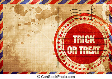 trick or treat, red grunge stamp on an airmail background -...