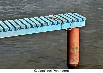 Empty wooden pier for boats - An empty wooden boat dock with...