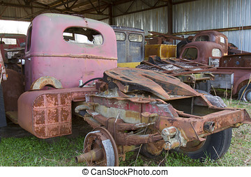 Old trucks in shed