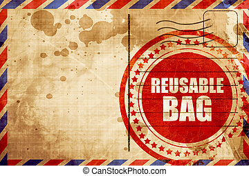 reusable bag, red grunge stamp on an airmail background