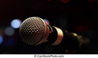 View at microphone on stage of nightclub. Spotlights. Live concert. Performance. Sound equipment