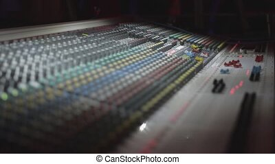 View at audio mixing console in nightclub. Volume. Live...