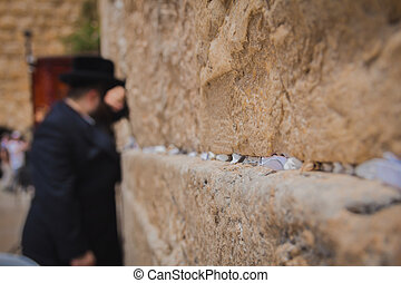 Religious orthodox jew praying at the Western Wall in the...