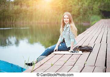 Pretty young woman traveling - Outdoor summer smiling...