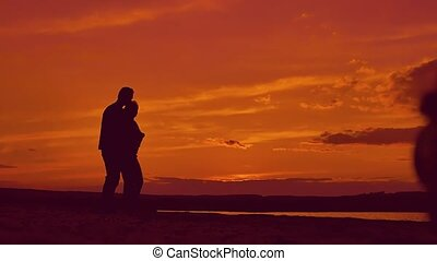 Silhouettes of people hugging slow motion video