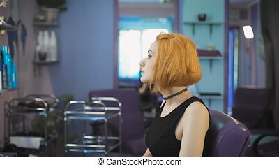 Portrait of a young girl in a beauty salon.