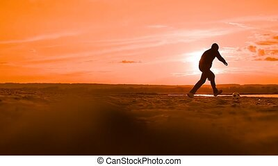 at sunset man tosses the ball up the slow motion video -...