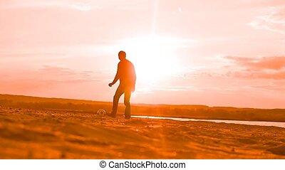 sunset in the background football two men Slow motion video...