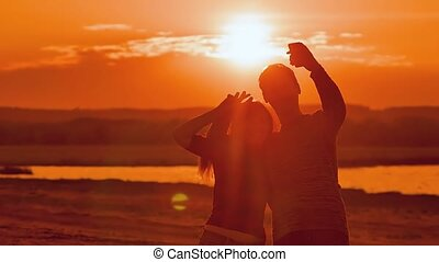 at sunset man and woman photographed selfie slow motion video
