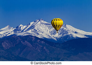Rocky Mountain Hot Air Balloon Festival - Bright yellow hot...