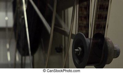 Dolly video of moving parts in pro cinema projector, 4K...