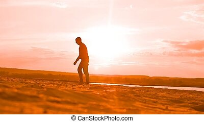 men running after a ball on the beach Slow motion video - at...