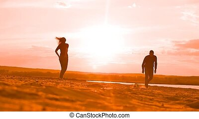 at sunset man playing soccer Slow motion video - on the...
