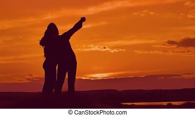 silhouettes of a woman with a man selfie slow motion video -...