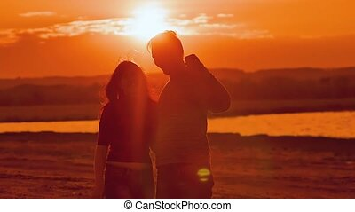 selfie shoot a girl with a guy at sunset slow motion video