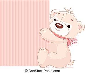 Teddy Bear Holds Sign