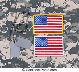 Small USA flag patches and ID tags on military battle dress...