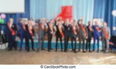 Students boys dance, sing songs at school hall - Students...