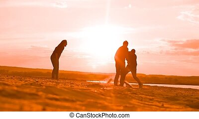 men playing football on the sand Slow motion video - at...