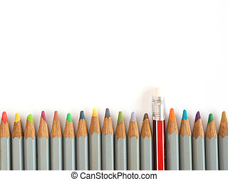 Colorful pencil and rubber arrange on the wooden table...