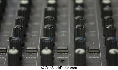 Knobs of professional cinema theater audio equipment 4K...