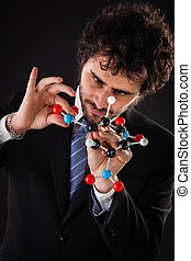 businessman building a tnt molecular structure - a...
