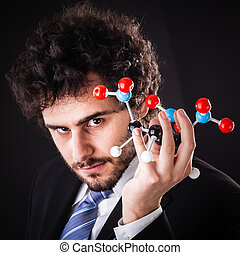 businessman holding tnt atomic structure - a businessman...
