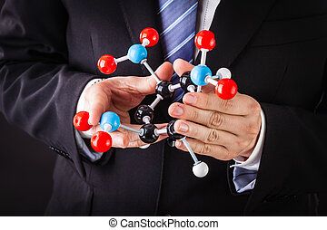 showing a tnt molecular structure - a businessman wearing a...