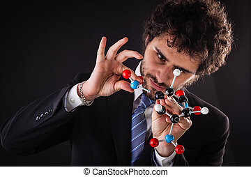 businessman building tnt molecular structure - a businessman...