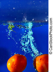 photography tomato splash in water