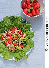 Fresh, vegetarian salad and a bowl of radish