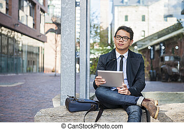Young asian man with digital tablet - Young asian business...