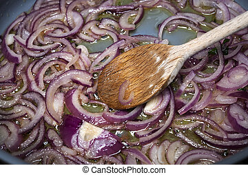 Sauteed onions - Stirring sauteing red onions with wooden...