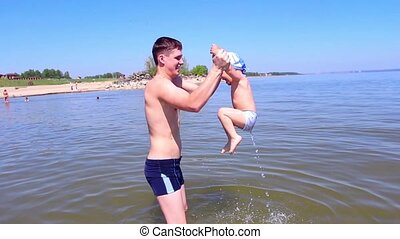 Young father and his little son have fun playing