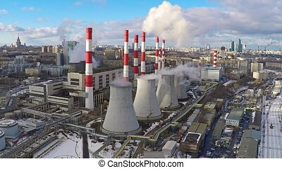 Aerial camera approaching electric power station in winter...