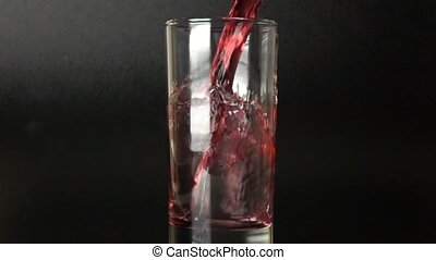 500 fps slow motion shot of cherry juice being poured in a...