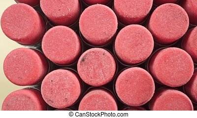 Numerous pink pencil erasers macro dolly shot clip