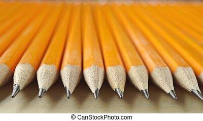 Identical sharp pencils, perspective view. Equality concept,...