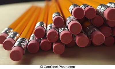 Pile of same pencils with erasers, dolly video