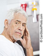 Sad Senior Man At Rehab Center - Portrait of sad senior man...